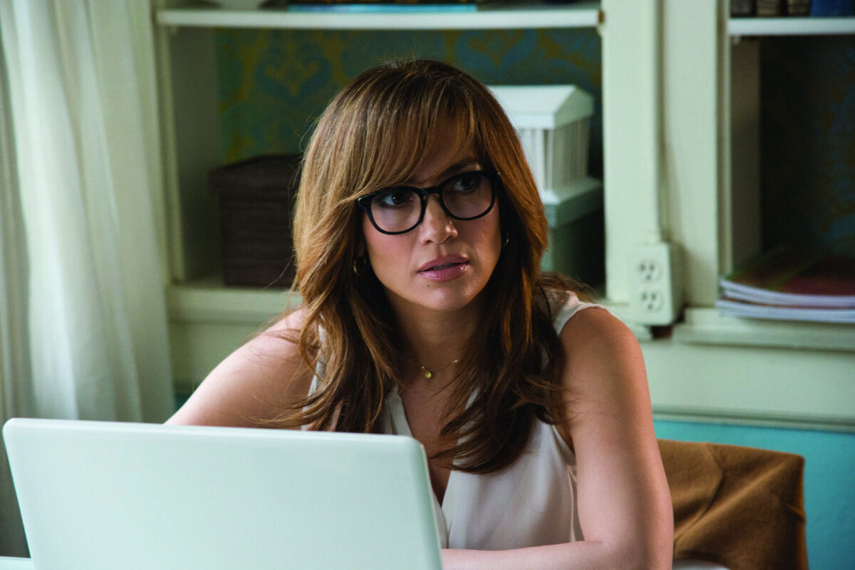"woman in glasses with computer in ""The Boy Next Door"""