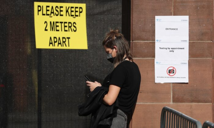 Members of the public queue outside the new walk-through testing center as it opened at Glasgow Caledonian University's ARC sports center in Edinburgh, Scotland, on Sept. 18, 2020. (Andrew Milligan-WPA Pool/Getty Images)