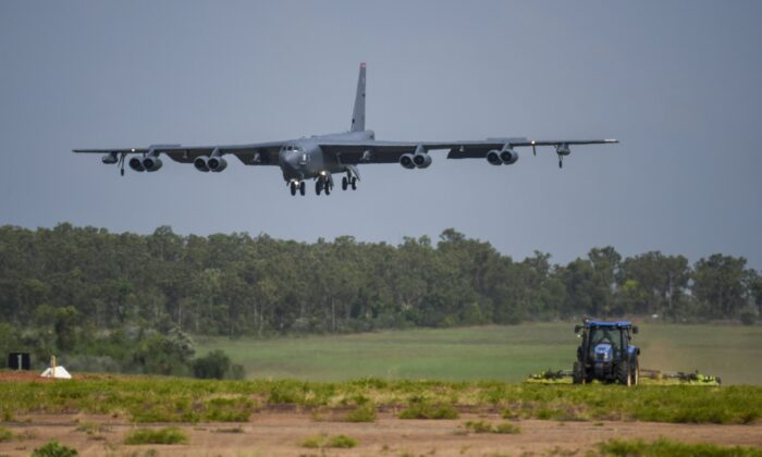A U.S. Air Force B-52 Stratofortress bomber, assigned to the 96th Expeditionary Bomb Squadron, deployed from Barksdale Air Force Base, La., lands during exercise Lightning Focus at Royal Australian Air Force Base (RAAF) in Darwin, Australia, on Dec. 6, 2018. (U.S. Air Force photo by Senior Airman Christopher Quail via AP)