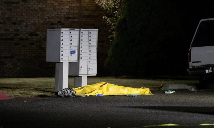 A tarpaulin covers the body of Michael Forest Reinoehl, in Lacey, Wash., on Sept. 4, 2020. (Caitlin Ochs/Reuters)