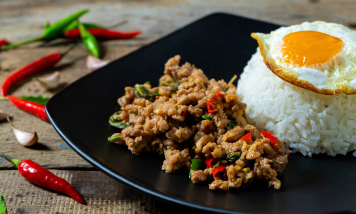 Serve pad krapow moo sap over rice, with an optional but recommended fried egg (khai dao). (Kritchai7752/Shutterstock)