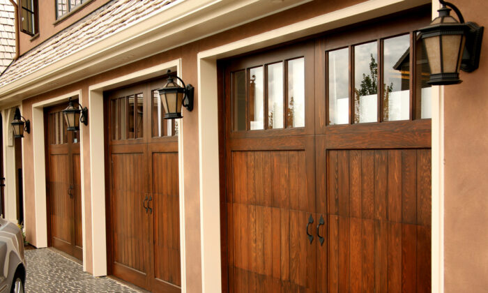 Building the garage door yourself allows you to create a unique design to complement your new garage decor. (Margot Petrowski/Shutterstock)