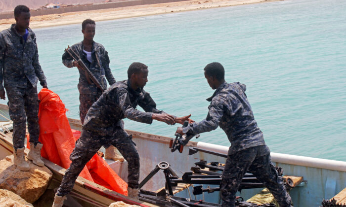 Somali Puntland forces receive weapons seized in a boat on the shores of the Gulf of Aden in the city of Bosasso, Puntland region, Somalia Sept. 23, 2017. (Abdiqani Hassan/Reuters)