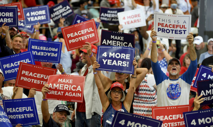 Supporters hold up signs during a campaign event for U.S. President Donald Trump at Xtreme Manufacturing in Henderson, Nev., on Sept. 13, 2020. (Ethan Miller/Getty Images)