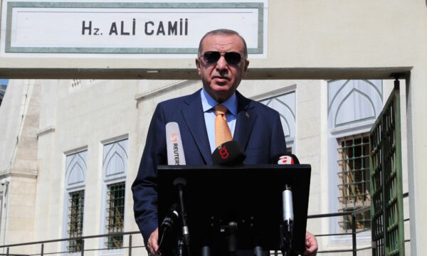 Turkey's President Recep Tayyip Erdogan talks to the media following Friday prayers at a mosque in Istanbul