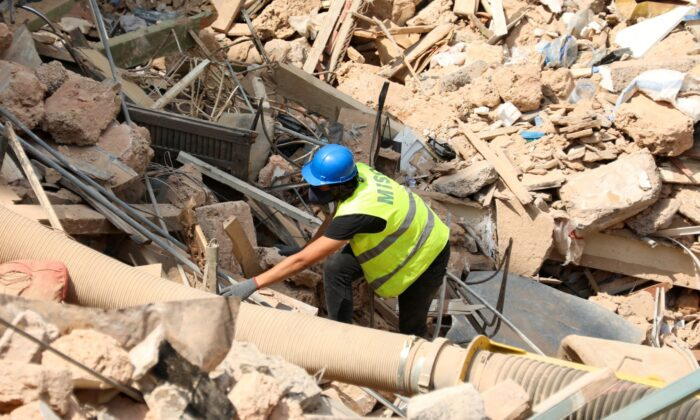A volunteer digs through the rubble of buildings which collapsed due to the explosion at the port area, after signs of life were detected, in Gemmayze, Beirut, Lebanon, on Sept. 5, 2020. (Mohamed Azakir/Reuters, File Photo)