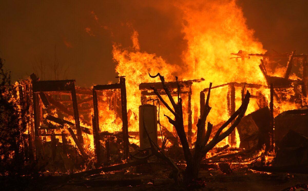 A home burns along Cima Mesa Rd.