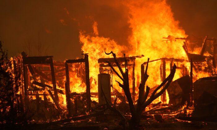 A home burns along Cima Mesa Rd. as the Bobcat Fire advances in Juniper Hills, Calif., on Sept. 18, 2020. (Marcio Jose Sanchez/AP Photo)