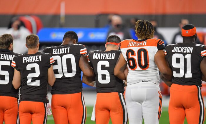 Players lock arms before the start of a game between the Cleveland Browns and the Cincinnati Bengals at FirstEnergy Stadium on September 17, 2020 in Cleveland, Ohio. (Jason Miller/Getty Images)
