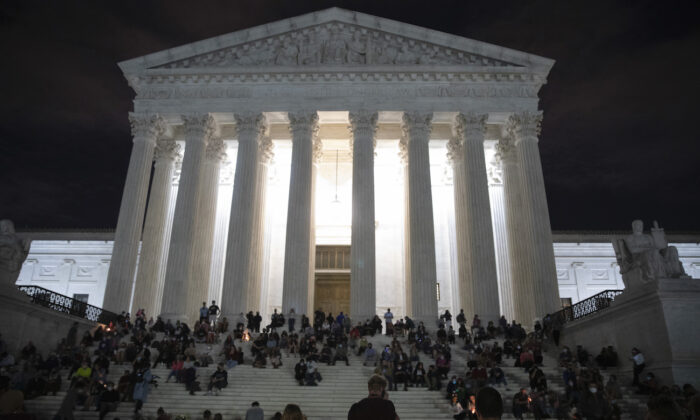 People gather to mourn the passing of Supreme Court Justice Ruth Bader Ginsburg at the steps in front of the Supreme Court in Washington, on Sept. 18, 2020. (Tasos Katopodis/Getty Images)