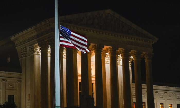 The American flag blows in the wind outside the Supreme Court building on Sept. 18, 2020. (Alex Brandon/AP Photo)