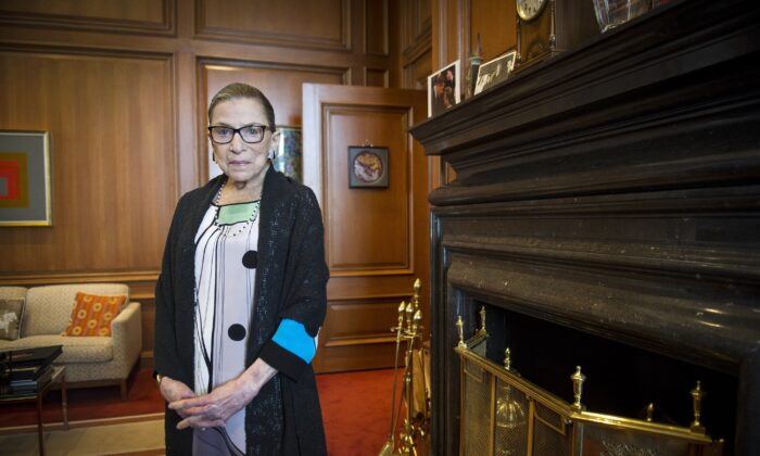 Associate Justice Ruth Bader Ginsburg is seen in her chambers in at the Supreme Court in Washington on July 31, 2014. (Cliff Owen/AP Photo)