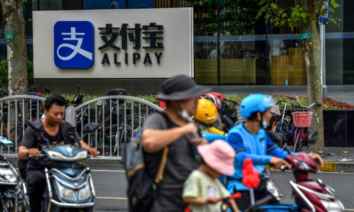 Motorists drive past an Alipay logo next to the Shanghai office building of Ant Group on Aug. 28, 2020. (HECTOR RETAMAL/AFP via Getty Images)
