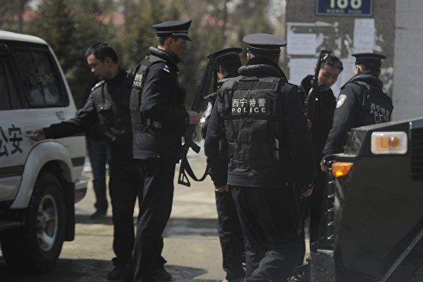 Armed Chinese police get ready to patrol a street in the county town of Banma in China's northwest Qinghai Province on March 10, 2012. (PETER PARKS/AFP/Getty Images)
