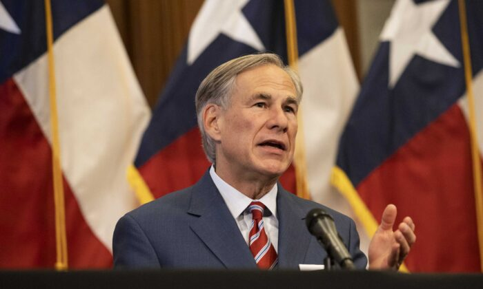 Texas Governor Greg Abbott announces the reopening of more Texas businesses during the COVID-19 pandemic at a press conference at the Texas State Capitol in Austin on Monday, May 18, 2020. (Lynda M. Gonzalez/Pool/Getty Images)