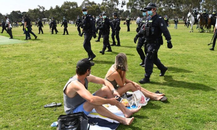 Police sweep through a park to break up an anti-lockdown protest in the Melbourne suburb of Elsternwick on Sept. 19, 2020. (William West/AFP via Getty Images)