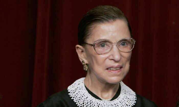 Supreme Court Justice Ruth Bader Ginsburg smiles during a photo session with photographers at the U.S. Supreme Court in Washington on March 3, 2006.  (Mark Wilson/Getty Images)