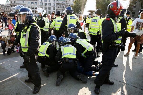 People gather in Trafalgar Square to protest against the lockdown imposed by the government, in London
