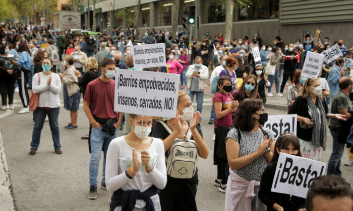 People protest in front of the Madrid regional government's health office over the lack of support and movement on improving working conditions at the Vallecas neighborhood, amid the outbreak of the coronavirus disease (COVID-19) in Madrid, Spain, on Sept. 20, 2020. (Javier Barbancho/Reuters)