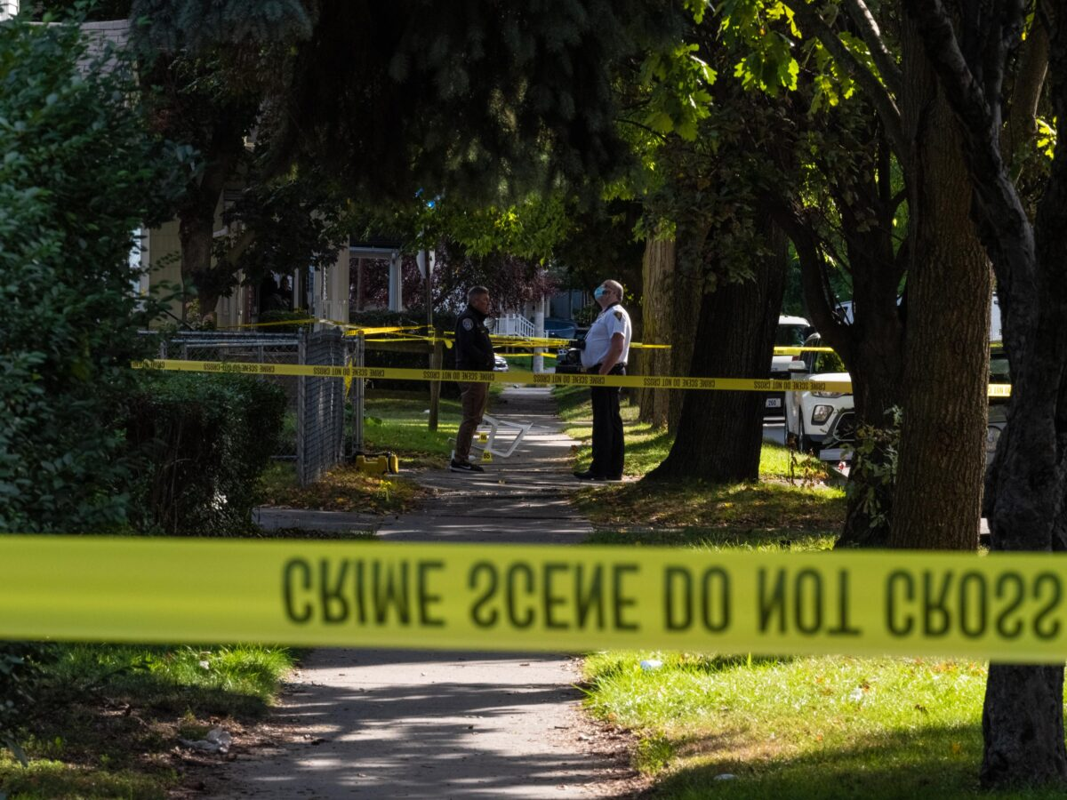 Police officers investigate the crime scene