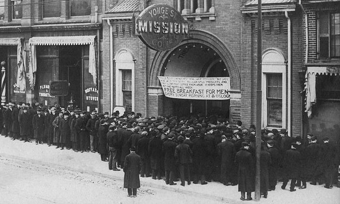 People wait in the food line at the Yonge Street Mission in Toronto during the Great Depression in the 1930s. (Public Domain)