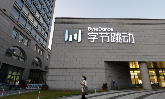 A woman walks past the headquarters of ByteDance, the parent company of video sharing app TikTok, in Beijing, China, on Sept. 16, 2020. (Greg Baker/AFP via Getty Images)