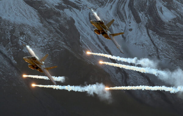 Swiss Air Force F/A18 Hornet fighter jets release flares during a flight demonstration of the Swiss Air Force