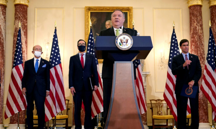 U.S. Secretary of State Mike Pompeo speaks next to Commerce Secretary Wilbur Ross, Treasury Secretary Steve Mnuchin, and Defense Secretary Mark Esper, during a news conference to announce the Trump administration's restoration of sanctions on Iran, at the U.S. State Department in Washington, U.S., Sept. 21, 2020. (Patrick Semansky/Pool via Reuters)