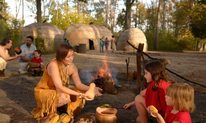 Young visitors enjoy the Powhatan Indian Village, which is based on archaeological findings, at the Jamestown Settlement. (Jamestown-Yorktown Foundation)