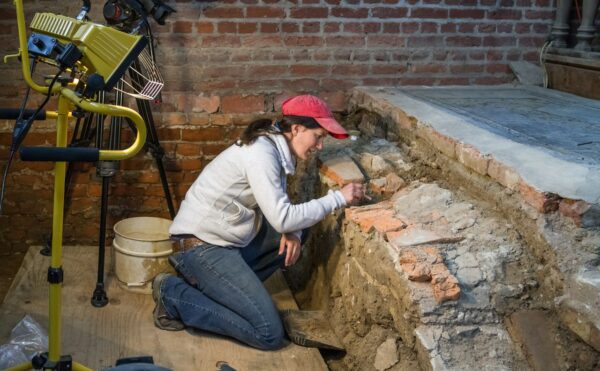 MA excavating in church