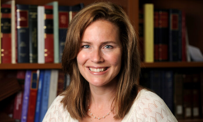 U.S. Court of Appeals for the Seventh Circuit Judge Amy Coney Barrett, a law professor at Notre Dame  University, poses in an undated photograph obtained from Notre Dame University, on Sept. 19, 2020. (Matt Cashore/Notre Dame University/Handout via Reuters)
