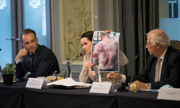 Belarusian opposition leader Sviatlana Tsikhanouskaya shows a picture