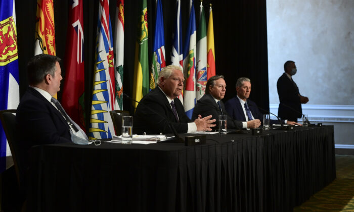 Ontario Premier Doug Ford (2nd L) speaks as Alberta Premier Jason Kenney (L), Quebec Premier Francois Legault (3rd R), and Manitoba Premier Brian Pallister (R) look on during a press conference in Ottawa on Sept. 18, 2020.  (Sean Kilpatrick/The Canadian Press)
