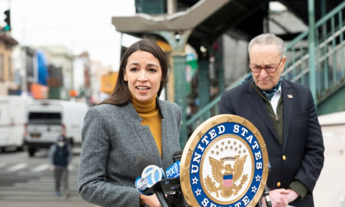 Rep. Alexandria Ocasio-Cortez (D-N.Y.) speaks as Senate Minority Leader Chuck Schumer (D-N.Y.) listens during a press conference in the Corona neighborhood of Queens in New York on April 14, 2020. (Johannes Eisele/AFP via Getty Images)