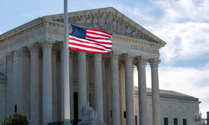 The U.S. flag flies at half-staff outside of the U.S. Supreme Court in memory of Justice Ruth Bader Ginsburg, in Washington on Sept. 19, 2020. (Jose Luis Magana/AFP via Getty Images)