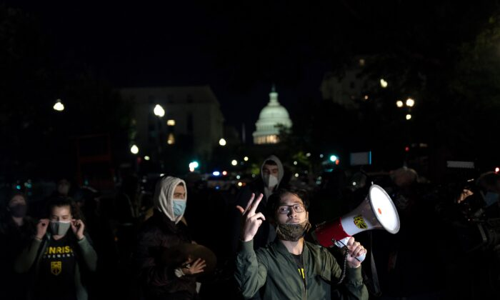 Protesters make noise outside the home of Sen. Lindsey Graham (R-S.C.) in Washington on Sept. 21, 2020. (Alex Edelman/AFP via Getty Images)