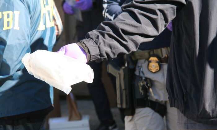 Federal authorities seized more than 100 pounds of methamphetamine and more than 30,000 Aderrall pills at two search sites from operations in Sunland, California, in February 2020. (Drug Enforcement Administration)