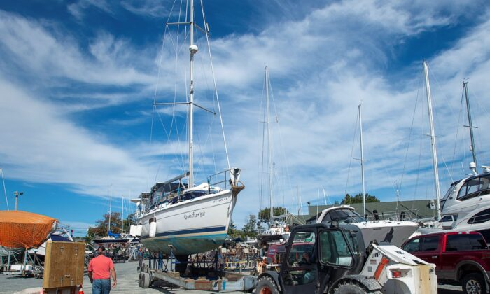 A sailboat is moved into the yard after being pulled from the water at the Dartmouth Yacht Club in Dartmouth, N.S., on Sept. 21, 2020. Hurricane Teddy is expected to impact the Atlantic region starting mid-day Tuesday as a post-tropical storm, bringing rain, wind and high waves. (Andrew Vaughan/The Canadian Press)