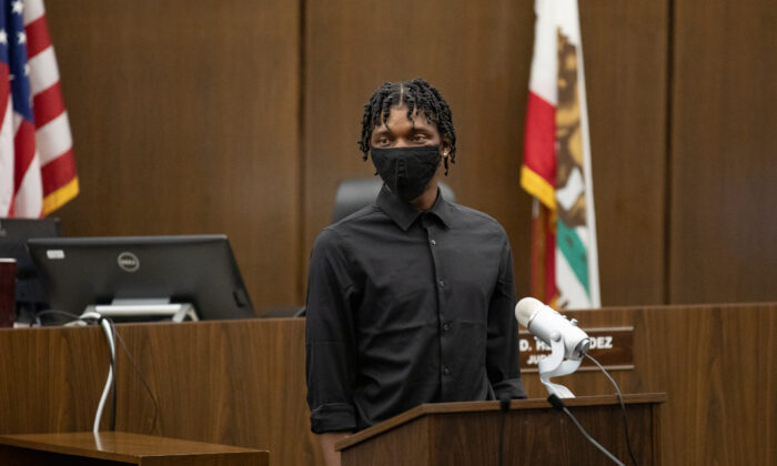 Zamire stands in the Central Justice Center in Santa Ana, Calif., to graduate from the Young Adult Court program, on Sept. 18, 2020. (John Fredricks/The Epoch Times)