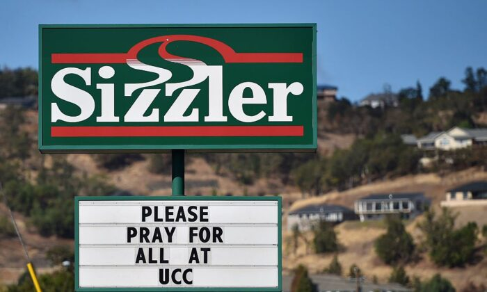 A sign at a Sizzler restaurant shows support for the victims of a shooting at Umpqua Community College in Roseburg, Ore., on Oct. 3, 2015. (Josh Edelson/AFP via Getty Images)