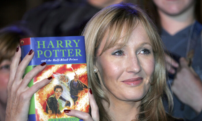 Harry Potter author J.K. Rowling and her children's book Harry Potter And The Half-Blood Prince (Photo by Christopher Furlong/Getty Images)