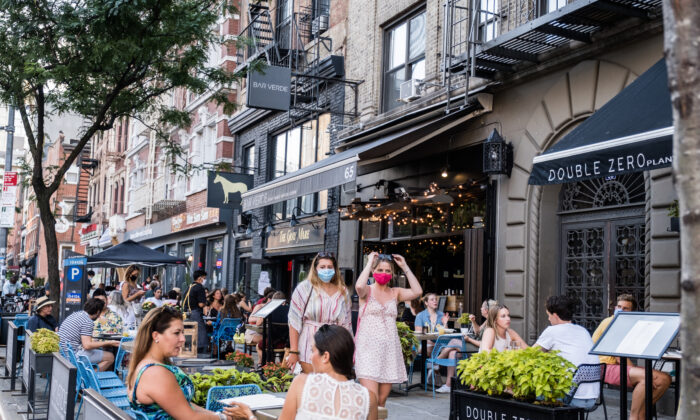 People dine al fresco, or in the open air, in the East Village in New York City, on July 21, 2020.  (Jeenah Moon/Getty Images)