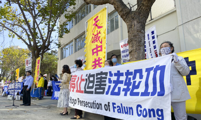 Protesters stand at the Chinese Consulate in San Francisco to raise awareness about the persecution of Falun Gong in China on Sept. 21, 2020. (Ilene Eng/The Epoch Times)