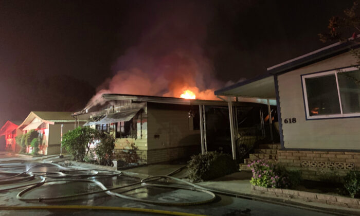 A deadly house fire burns in a mobile home park in Westminster, Calif., on Sept. 14, 2020. (Courtesy of the Orange County Fire Authority)