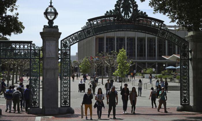 Students walk past Sather Gate on the University of California at Berkeley campus in Berkeley, Calif., May 10, 2018. (Ben Margot/AP Photo)