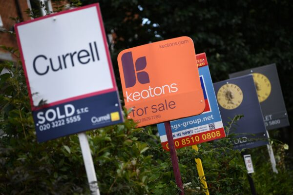 Estate and rental agents' boards are pictured on a residential street in Hackney in East London