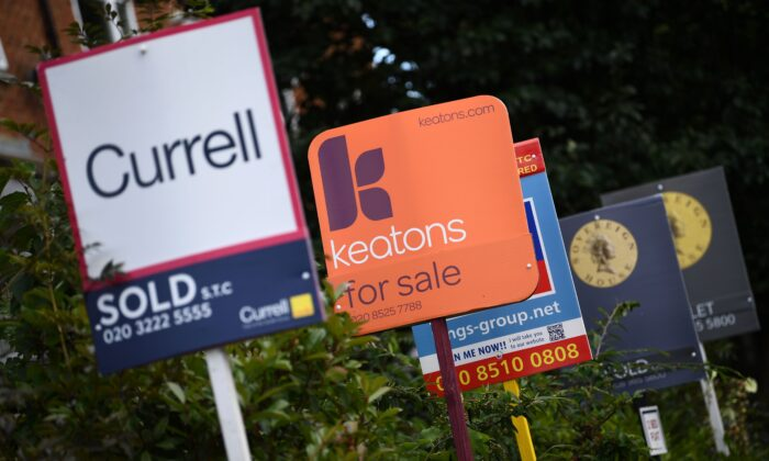 Estate and rental agents' boards are pictured on a residential street in Hackney in East London on Aug. 9, 2019. (Daniel Leal-Olivas/AFP via Getty Images)