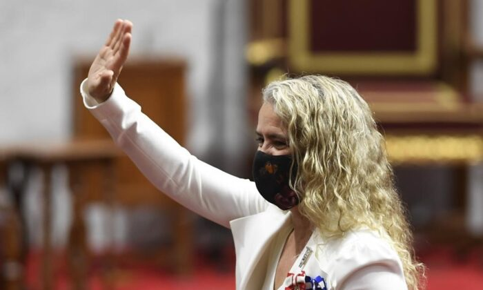 Gov.Gen. Julie Payette waves as she waits prior to delivering the throne speech in the Senate chamber in Ottawa on Sept. 23, 2020. (Adrian Wyld/The Canadian Press)