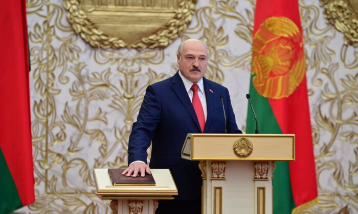 Alexander Lukashenko takes the oath of office as Belarusian President during a swearing-in ceremony in Minsk, on Sept. 23, 2020. (Andrei Stasevich/BelTA/Handout via Reuters)
