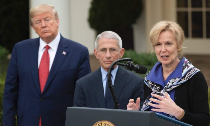 Dr. Deborah Birx (R), response coordinator, speaks with President Donald Trump and Director of the National Institute of Allergy and Infectious Diseases Dr. Anthony Fauci during a Coronavirus Task Force press briefing in the Rose Garden of the White House in Washington, on March 29, 2020. (Jim Watson/AFP via Getty Images)